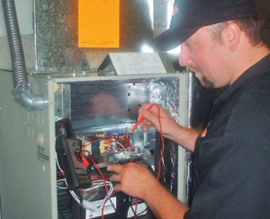 A technician inspecting AC system